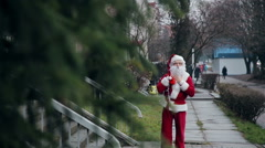 Santa Claus near the tree - stock footage