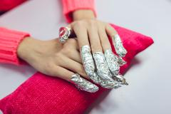 Manicure. Beauty saloon. Close-up. Remove old nail polish Stock Photos