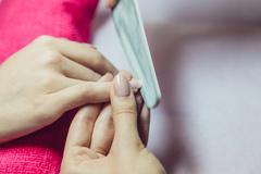 Manicure. Beauty saloon. Close-up. Remove old nail polish - stock photo