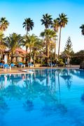 Outdoor resort Swimming pool in Tropical Paradise. spa resort. - stock photo