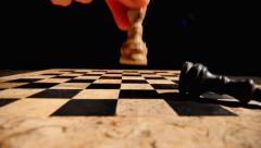 Footage of two chess king pieces standing in the center of a chess board - stock footage