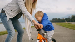 Mother and son on the bicycle outdoor Stock Footage