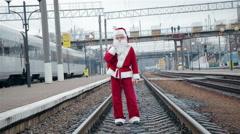 Santa Claus on train tracks - stock footage
