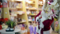 Santa Claus with a bag out of the store - stock footage