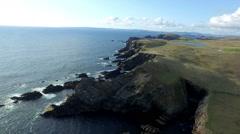 Aerial shot off the dramatic coast line of Shetland, Scotland, Stock Footage