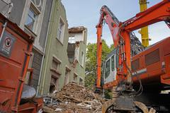 Crane close up, tearing down a house Stock Photos