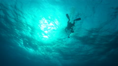 Stock Video Footage of scuba diver swims at sunlight - underwater silhouette shot