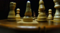 A chess with it´s pieces lined up, the shot moves behind the white figures Stock Footage