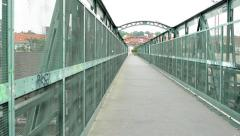 View of the iron bridge with tall iron walls in the suburb - graffiti Stock Footage