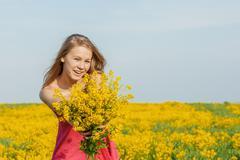 Beautiful cheerful woman spring field Stock Photos
