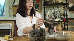 Artist woman sculpts from a clay Stock Footage