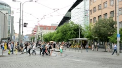 Many people walk over the road in the busy city  Stock Footage