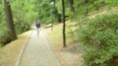 Young handsome man walk to the camera from the distance - blend view  Stock Footage
