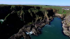 Aerial shot of sea cliffs off the coast of Scotland near Aberdeen Stock Footage