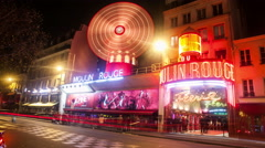 A Timelapse View on Moulin Rouge in Paris in France by Night Stock Footage