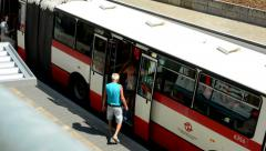 Bus arrives to the platform many people get in - view from above Stock Footage