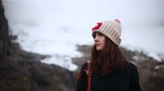 Woman hiker looking at mountain landscape - stock footage