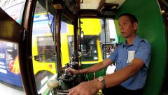 Man drives the vintage double-deck tram in Hong Kong, China. Stock Footage