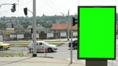 View of the empty billboard by the road in the suburb - city in the distance  Stock Footage