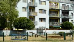 View of the children playground behind the prefab houses in the suburb  Stock Footage