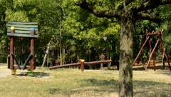 View of the children playground in the forest - wooden equipment  Stock Footage