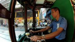 Man drives the vintage double-deck tram in Hong Kong, China. - stock footage