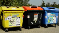 View of the garbage containers in the suburb on the sidewalk Stock Footage