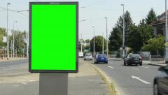 View of the billboard stands on the side of two roads in suburb - green screen Stock Footage