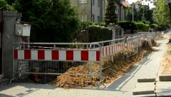 View of the reconstruction of the sidewalk before the family houses Stock Footage