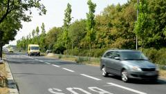 view of the road in the nature - many cars pass through the countryside  - stock footage