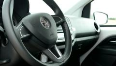 View of the steering wheel inside of modern car - detail Stock Footage