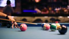 Playing Eight-ball pool billiards in a bar - stock footage