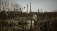 gas mask in dead forest - stock footage