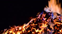 beautiful red hot glowing ember pile with colorful flames in winter night - stock footage