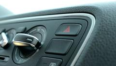 Man turns on warning lights in the modern car - detail view Stock Footage