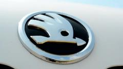 View of the glosyy symbol of skoda cars - detail  Stock Footage