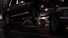 NYPD officer working on car alarm of vehicle attached to tow truck, NYC 1080 HD Stock Footage