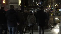 People crossing crosswalk at night in Manhattan street with bright lights NYC Stock Footage