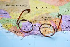 Glasses on a map - Ghana - stock photo