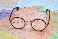 Glasses on a map - Algeria Stock Photos