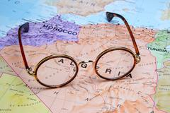 Glasses on a map - Algeria - stock photo