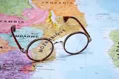 Glasses on a map - Mozambique Stock Photos