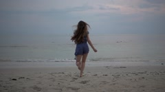 Stock Video Footage of Long Hair Girl Running on the Beach at Sunrise