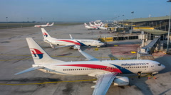 Time Lapse - Malaysia Airlines (MAS) planes on airport tarmac ready to depart. - stock footage
