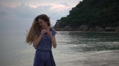 Girl Playing with Her Hair on the Beach at Sunrise Stock Footage