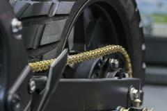 Zoom motorcycle chain and sprocket in Car show event - stock photo