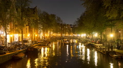 Time Lapse -  Boat Cruising Down Canal at Night  - Amsterdam Netherlands Stock Footage