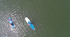 Aerial pull up shot on some Paddleboarders Stock Footage