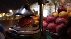 Making pomegranate juice - stock footage