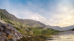 Beautiful pond in Tatra mountains with helicopter Stock Footage